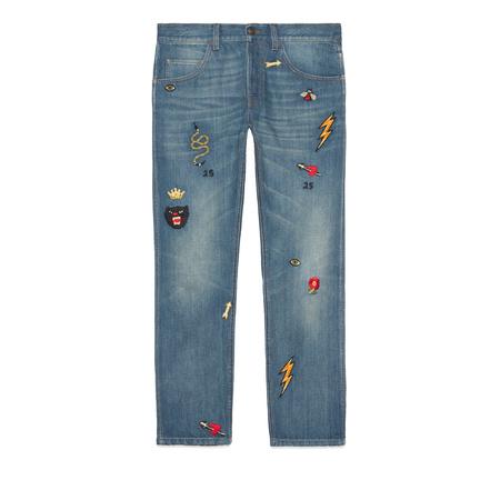 Gucci Abgeschrägte Hose aus Denim mit Symbolen grau